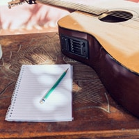 A songwriter getting inspiration but his suroundings