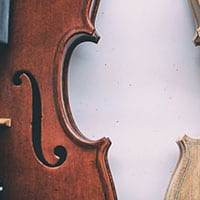 In what way is a fiddle different than a violin?
