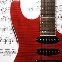 Is learning to read sheet music important in the music industry?
