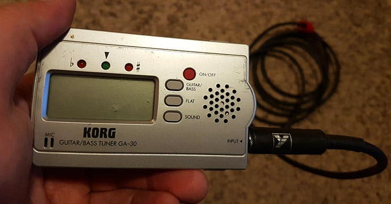 Guitar tuner with instrument cable