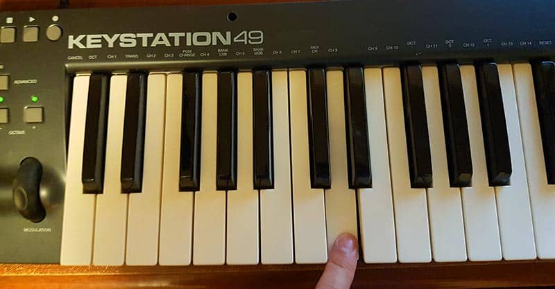 Tuning guitar with a piano - D