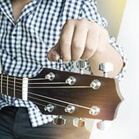Should you tune your guitar by ear or with a tuner?