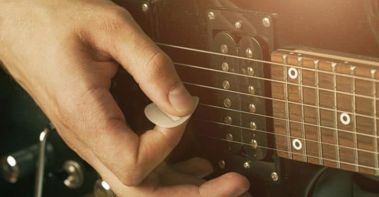 How To Hold A Guitar Pick Correctly (For Strumming, Speed & The Like)