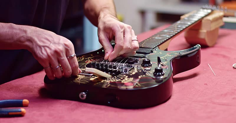 How Much Does It Cost To Restring A Guitar?